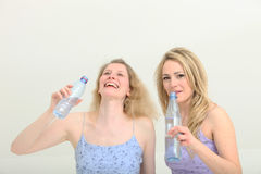 Pretty girls share a moment while getting a drink Royalty Free Stock Photography