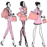 Pretty girls with shopping bags Stock Images