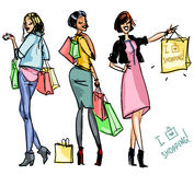 Pretty girls with shopping bags Royalty Free Stock Photos