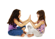 Pretty girls sitting on the floor and playing stock photo