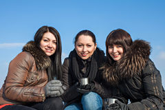 Pretty girls smiling with cup of tea Stock Photo
