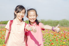 Pretty girls in spring garden Stock Image