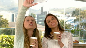 Pretty girls taking a selfie with coffee cups stock video footage