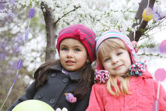 Pretty girls together holding painted egg Royalty Free Stock Photo
