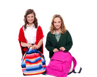 Pretty girls unzipping school bag Royalty Free Stock Photo