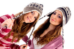 Pretty girls wearing cap and looking at camera Stock Image
