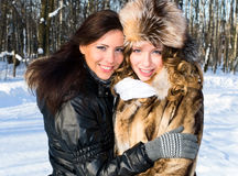 Pretty girls in winter forest Royalty Free Stock Photography