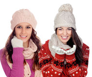 Pretty girls with woolen clothes smiling Royalty Free Stock Image