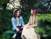 Pretty girls young friends chatting outdoors, lifestyle portrait.  stock photography