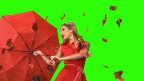 Pretty glamour woman holding a broken umbrella on green screen stock video