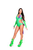 Pretty go-go dancer in green costume. Posing over white background Stock Photos