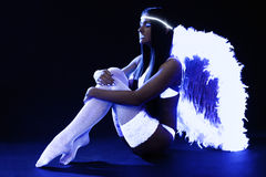 Pretty go-go girl in angel costume Royalty Free Stock Photo