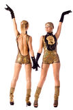 Pretty go-go girls in gold costumes Royalty Free Stock Photos