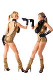 Pretty go-go girls in gold costumes isolated Stock Image
