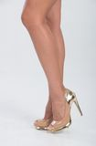 Pretty in gold four inch heels Stock Photography