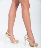 Pretty in gold four inch heels Royalty Free Stock Photos