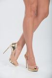 Pretty in gold four inch heels Stock Images