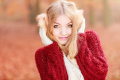 Pretty gorgeous woman in earmuffs. Stock Image