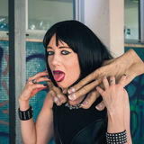 Pretty goth girl choked by two hands Royalty Free Stock Photo