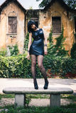 Pretty goth girl posing in a city park Royalty Free Stock Photo