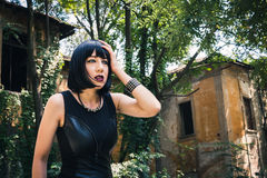Pretty goth girl posing in a city park Royalty Free Stock Images