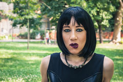 Pretty goth girl posing in a city park Royalty Free Stock Photos