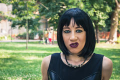 Pretty goth girl posing in a city park Royalty Free Stock Photography