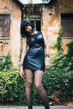 Pretty goth girl posing in a city park Stock Photography