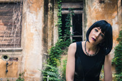 Pretty goth girl posing in a city park Stock Images