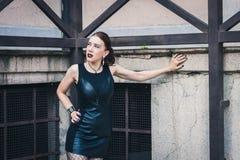 Pretty goth girl posing in urban landscape Stock Image