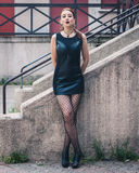 Pretty goth girl posing in urban landscape Stock Photos