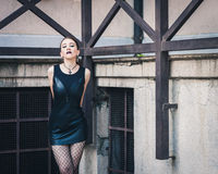 Pretty goth girl posing in urban landscape Stock Images