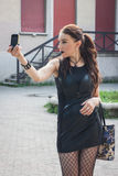 Pretty goth girl taking a selfie with her phone Royalty Free Stock Photos