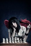 Pretty gothic with chess board Royalty Free Stock Photography