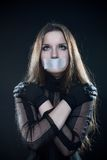 Pretty gothic girl in corset with sealed mouth. Looking up Royalty Free Stock Photo