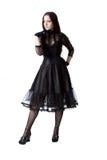 Pretty gothic girl posing over white. Pretty gothic girl in black dress posing over white Royalty Free Stock Image