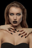 Pretty gothic woman with hands of vampire on her Stock Images