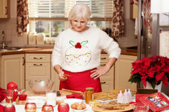 Pretty grandmother in kitchen, christmas time. Stock Photos