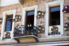 Pretty greek balcony and flower pots Royalty Free Stock Image