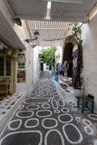 Pretty Greek Path with stores in Ios island, Cyclades, Greece. Royalty Free Stock Photo