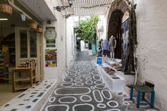 Pretty Greek Path with stores in Ios island, Cyclades, Greece. Royalty Free Stock Images
