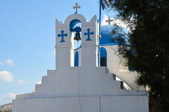 Pretty greek stone church with blue dome and walls whitewashed Royalty Free Stock Photography