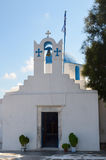 Pretty greek stone church with blue dome and walls whitewashed Royalty Free Stock Images