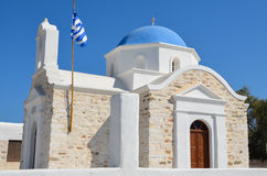 Pretty greek stone church with blue dome and walls whitewashed Royalty Free Stock Image