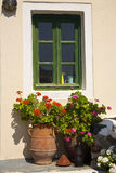 Pretty Greek Window and Flower Pots. On the island of Santorini, Greece Royalty Free Stock Photos