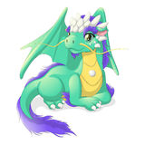 Pretty green dragon. Lying cute green dragon with the talisman on his chest Stock Photography