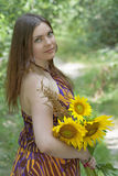 Pretty green eyes woman with sunflowers stock image