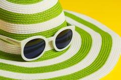 Pretty green hat with sunglasses Stock Photo