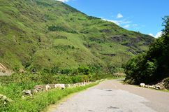 Pretty green hills and open road in Himachal Pradesh, India Stock Image