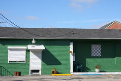 A pretty green wooden house Royalty Free Stock Photography
